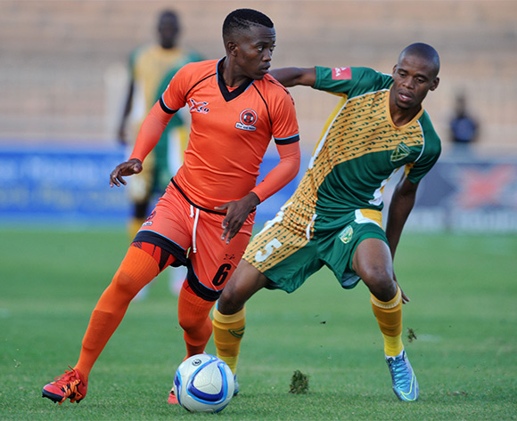 Tokelo Langa of Polokwane City challenged by Gladwin Shitolo of Golden Arrows during the Absa Premiership match between Polokwane City and Golden Arrows at the Old Peter Mokaba Stadium in Polokwane, South Africa on February 13, 2016 ©Samuel Shivambu/BackpagePix