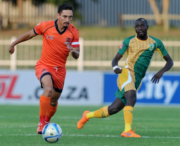 Cole Alexander of Polokwane City challenged by Deon Hotto of Golden Arrows during the Absa Premiership match between Polokwane City and Golden Arrows at the Old Peter Mokaba Stadium in Polokwane, South Africa on February 13, 2016 ©Samuel Shivambu/BackpagePix