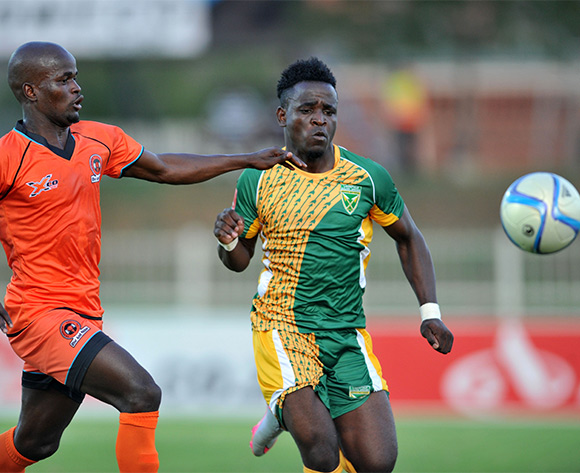 Gabadinho Mhango of Golden Arrows challenged by Cole Simphiwe Hlongwane of Polokwane City during the Absa Premiership match between Polokwane City and Golden Arrows at the Old Peter Mokaba Stadium in Polokwane, South Africa on February 13, 2016 ©Samuel Shivambu/BackpagePix