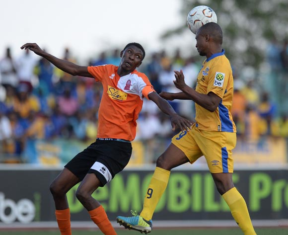 Jerome Ramatlhakwana of Township Rollers and Bonang Monyatsi of Gilport Lions during the beMobilepremier league match between Township rollers  and Gilport Lions at the Molepolole Sports complex on 14 February 2016. MONIRUL BHUIYAN/Backpagepix