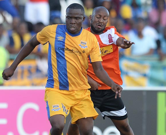 Galabgwe Moyana of Township Rollers and Kenamile Mani of Gilport Lions during the beMobilepremier league match between Township rollers  and Gilport Lions at the Molepolole Sports complex on 14 February 2016. MONIRUL BHUIYAN/Backpagepix