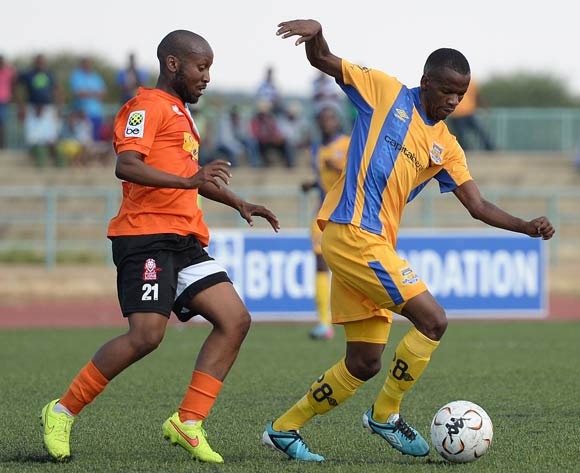 Motsholetsi Sikele of Township Rollers and Kenamile Mani of Gilport Lions during the beMobilepremier league match between Township rollers  and Gilport Lions at the Molepolole Sports complex on 14 February 2016. MONIRUL BHUIYAN/Backpagepix