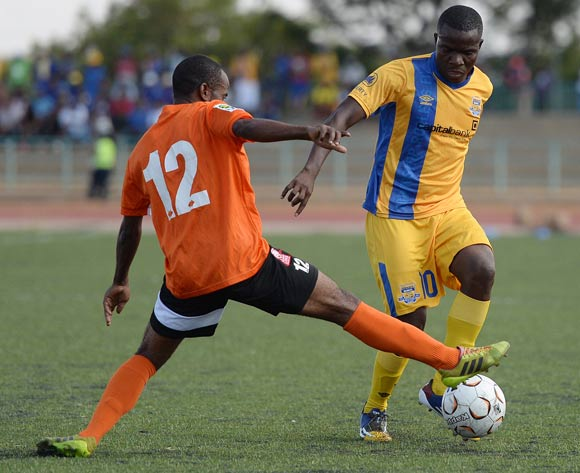 Galabgwe Moyana of Township Rollers and Sekgabo Molebatsi of Gilport Lions during the beMobilepremier league match between Township rollers  and Gilport Lions at the Molepolole Sports complex on 14 February 2016. MONIRUL BHUIYAN/Backpagepix