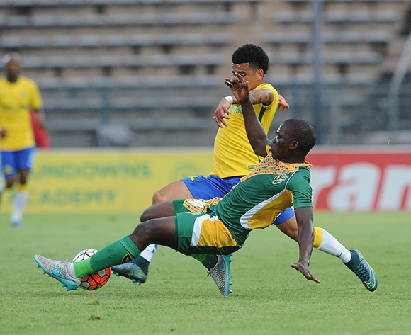 Siyabonga Dube of Golden Arrows tackles Keagan Dolly of Mamelodi Sundowns during the Absa Premiership match between Mamelodi Sundowns and Golden Arrows on 20 February 2016 at Lucas Moripe Stadium Pic Sydney Mahlangu/ BackpagePix