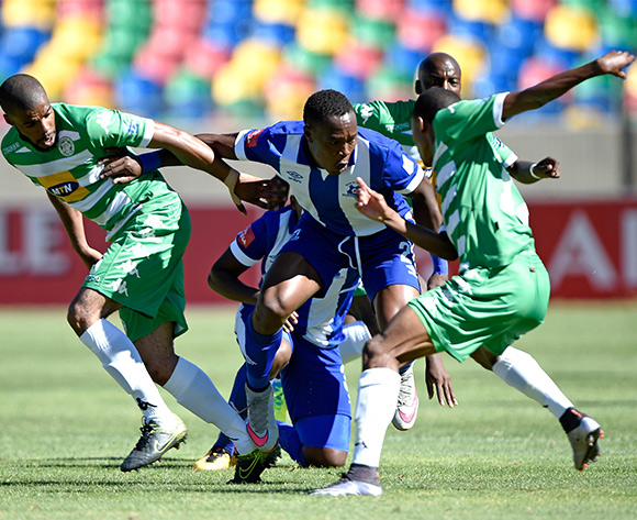 Wandisile Letlabika of Bloemfontein Celtic challenged by Philani Zulu from Maritzburg United during the Absa Premiership match between Bloemfontein Celtic FC and Maritzburg United at Dr Molemela Stadium on 21 February 2016.