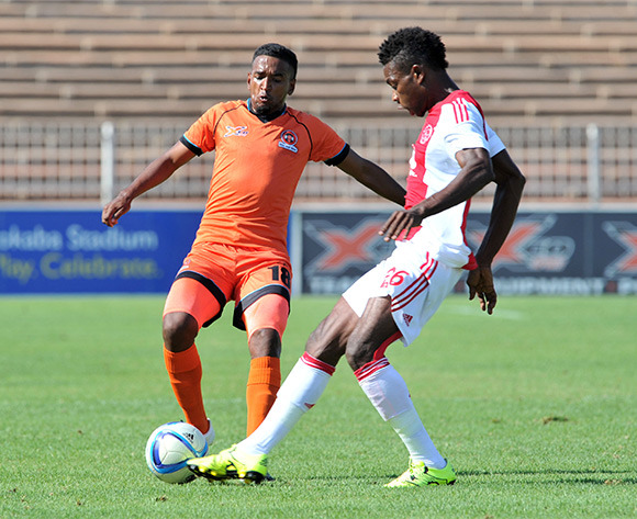 Mogamat Jacobs (l) of Polokwane City challenged by Lawrence Lartey (r) of Ajax Cape Town during the Absa Premiership match between Polokwane City and Ajax Cape Town at the Old Peter Mokaba Stadium in Polokwane, South Africa on February 20, 2016 ©Samuel Shivambu/BackpagePix