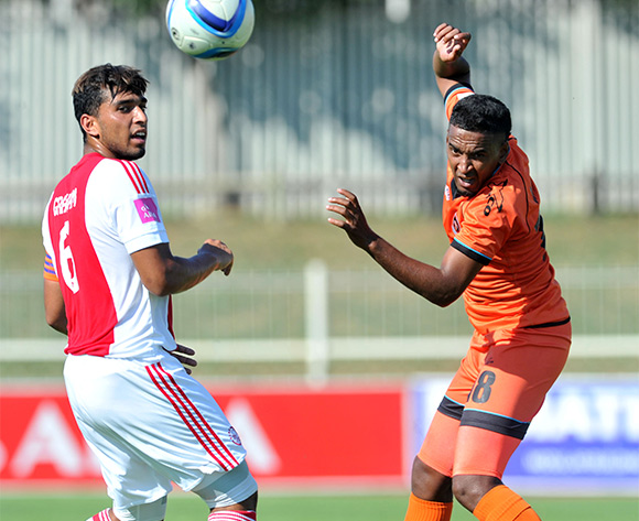 Mogamat Jacobs (r) of Polokwane City challenged by Travis Graham (l) of Ajax Cape Town during the Absa Premiership match between Polokwane City and Ajax Cape Town at the Old Peter Mokaba Stadium in Polokwane, South Africa on February 20, 2016 ©Samuel Shivambu/BackpagePix