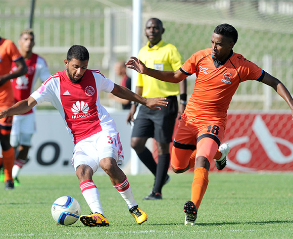 Riyaad Norodien (l) of Ajax Cape Town challenged by Mogamat Jacobs (r) of Polokwane City during the Absa Premiership match between Polokwane City and Ajax Cape Town at the Old Peter Mokaba Stadium in Polokwane, South Africa on February 20, 2016 ©Samuel Shivambu/BackpagePix