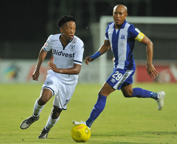 Paseka Sekese of Bidvest Wits challenged by Kurt Lentjies of Maritzburg United during the Absa Premiership 2015/16 match between Maritzburg United and Bidvest Wits in Harry Gwala Stadium Pietermaritzburg, Kwa-Zulu Natal on 24 February 2016©Muzi Ntombela/Backpagepix