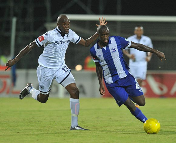 Kwanda Mngonyama of Maritzburg United challenged by Sfiso Hlanti of Bidvest Wits during the Absa Premiership 2015/16 match between Maritzburg United and Bidvest Wits in Harry Gwala Stadium Pietermaritzburg, Kwa-Zulu Natal on 24 February 2016©Muzi Ntombela/Backpagepix