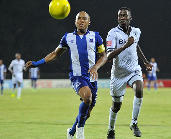 Kurt Lentjies of Maritzburg United challenged by Buhle Mkhwanazi of Bidvest Wits during the Absa Premiership 2015/16 match between Maritzburg United and Bidvest Wits in Harry Gwala Stadium Pietermaritzburg, Kwa-Zulu Natal on 24 February 2016©Muzi Ntombela/Backpagepix