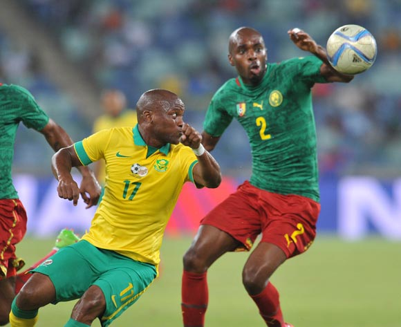 Tokelo Rantie of South Africa challenged by Allan Romeo Nyom of Cameroon during the 2017 AFCON Qualifier match between South Africa and Cameroon at Moses Mabhida Stadium, Durban Kwa-Zulu Natal on 29 March 2016 ©Muzi Ntombela/Backpagepix