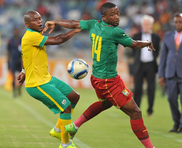 Tokelo Rantie of South Africa challenged by Aurelien Cheudjou of Cameroon during the 2017 AFCON Qualifier match between South Africa and Cameroon at Moses Mabhida Stadium, Durban Kwa-Zulu Natal on 29 March 2016 ©Muzi Ntombela/Backpagepix
