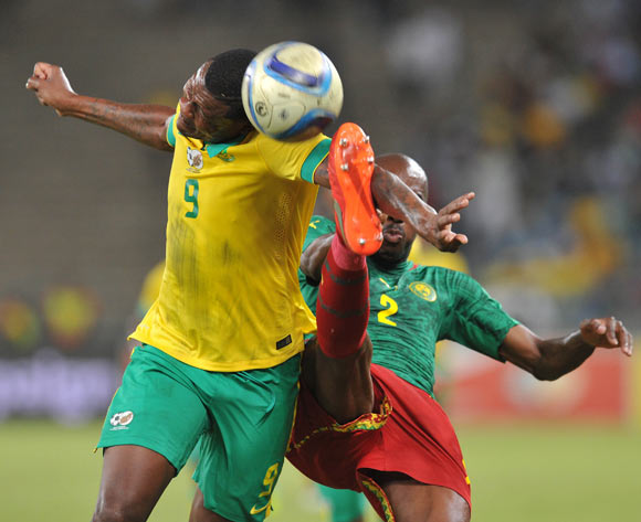 Thamsanqa Gabuza of South Africa challenged by Allan Romeo Nyom of Cameroon during the 2017 AFCON Qualifier match between South Africa and Cameroon at Moses Mabhida Stadium, Durban Kwa-Zulu Natal on 29 March 2016 ©Muzi Ntombela/Backpagepix