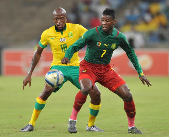 Anatole Abang of Cameroon challenged by Sifiso Hlanti of South Africa during the 2017 AFCON Qualifier match between South Africa and Cameroon at Moses Mabhida Stadium, Durban Kwa-Zulu Natal on 29 March 2016 ©Muzi Ntombela/Backpagepix