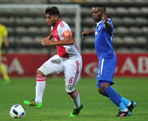 Travis Graham of Ajax Cape Town gets away from Andile Mbenyane of Chippa United during the Absa Premiership 2015/16 football match between Ajax Cape Town and Chippa United at Athlone Stadium, Cape Town on 1 March 2016 ©Chris Ricco/BackpagePix