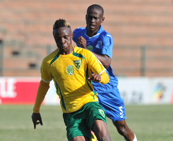 Kudakwashe Mahachi of Golden Arrows challenged by Manda Ndou of Milford FC during the 2016 Nedbank Cup match between Golden Arrows and Milford FC in King Zwelithini Stadium Umlazi, Kwa-Zulu Natal on 05 March 2016©Muzi Ntombela/Backpagepix