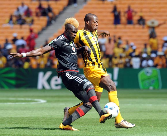 Edwin Gyimah of Orlando Pirates challenges Camaldine Abraw of Kaizer Chiefs during the 2016 Nedbank Cup Last 32 match between Orlando Pirates and Kaizer Chiefs on 05 March 2016 at FNB Stadium  Pic Sydney Mahlangu/ BackpagePix