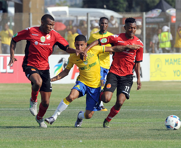 Richard Matloga of Highlands Park(R) and Mothobi Mvala of Hollands Park  challenge Keagan Dolly  of Mamelodi Sundowns during the 2016 Nedbank Cup Last 32 match between Highlands Park and Mamelodi Sundowns on 06 March 2016 at Makhulong Stadium Pic Sydney Mahlangu/ BackpagePix