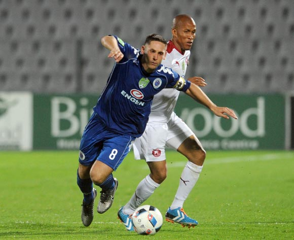 Josta Dladla of Mowallows is challenged by Dean Furman of Supersport United   during the 2016 Nedbank Cup Last 32 match between Moroka Swallows and Supersport United on 08 March 2016 at Dobsonville Stadium Pic Sydney Mahlangu/ BackpagePix