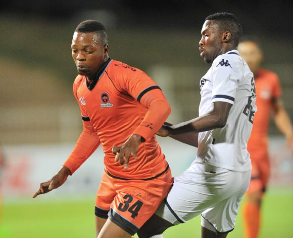 Muzikayifani Ngid (l) of Polokwane City challenged by Thulani Hlatshwayo (r) of Bidvest Wits during the Absa Premiership match between Polokwane City and Bidvest Wits at the Old Peter Mokaba Stadium in Polokwane, South Africa on March 09, 2016 ©Samuel Shivambu/BackpagePix
