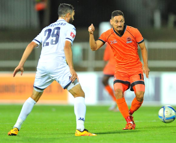 Cole Alexander (l) of Polokwane City challenged by Dillon Sheppard (r) of Bidvest Wits during the Absa Premiership match between Polokwane City and Bidvest Wits at theOld Peter Mokaba Stadium in Polokwane, South Africa on March 09, 2016 ©Samuel Shivambu/BackpagePix