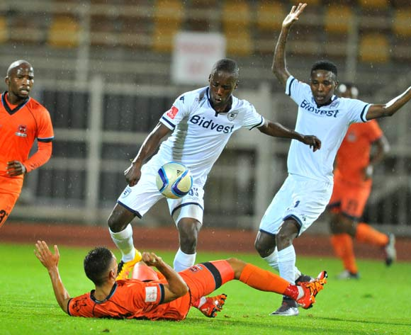 Alexander Cole (f) of Polokwane City challenged by Ben Motshwari (c) of Bidvest Wits during the Absa Premiership match between Polokwane City and Bidvest Wits at the Old Peter Mokaba Stadium in Polokwane, South Africa on March 09, 2016 ©Samuel Shivambu/BackpagePix