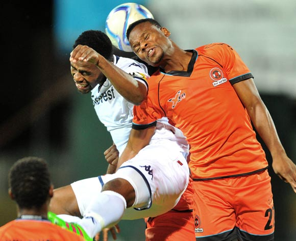 Thobani Mncwango (r) of Polokwane City challenged by Thulani Hlatshwayo (l) of Bidvest Wits during the Absa Premiership match between Polokwane City and Bidvest Wits at theOld Peter Mokaba Stadium in Polokwane, South Africa on March 09, 2016 ©Samuel Shivambu/BackpagePix