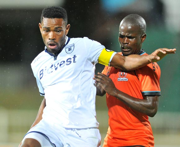 Thulani Hlatshwayo (l) of Bidvest Wits challenged by Simphiwe Hlongwane (r) of Polokwane City during the Absa Premiership match between Polokwane City and Bidvest Wits at theOld Peter Mokaba Stadium in Polokwane, South Africa on March 09, 2016 ©Samuel Shivambu/BackpagePix