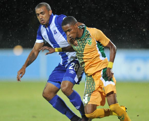 Mahlatsi Makudubela of Golden Arrows challenged by Deolin Mekoa of Martizburg United during the Absa Premiership 2015/16 match between Maritzburg United and Golden Arrows in Harry Gwala Stadium Pietermaritzburg, Kwa-Zulu Natal on 11 March 2016©Muzi Ntombela/Backpagepix