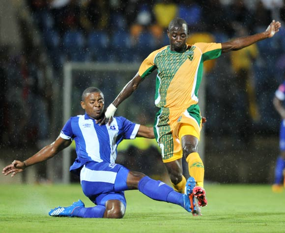 Deon Hotto of Golden Arrows tackled by Thamsanqa Teyise of Maritzburg United during the Absa Premiership 2015/16 match between Maritzburg United and Golden Arrows in Harry Gwala Stadium Pietermaritzburg, Kwa-Zulu Natal on 11 March 2016©Muzi Ntombela/Backpagepix