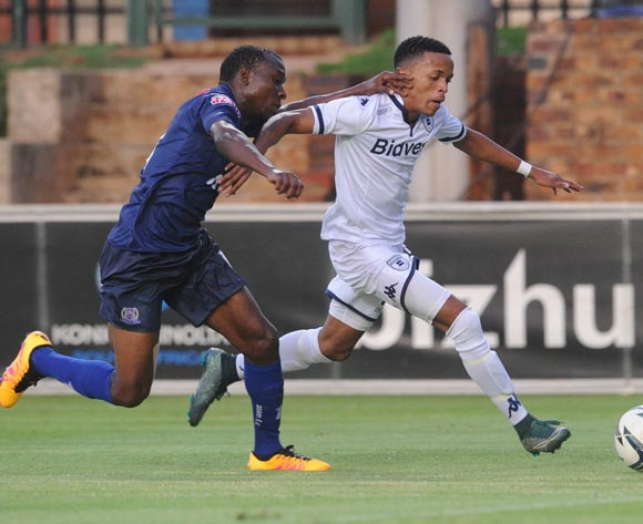Koiekantse Mosiatlahaga of Bidvest Wits is challenged by Agrey Moris of Azam FC  during the CAF Confederation Cup match between Bidvest Wits and Azam on 12 March 2016 at Bidvest Stadium Pic Sydney Mahlangu/ BackpagePix