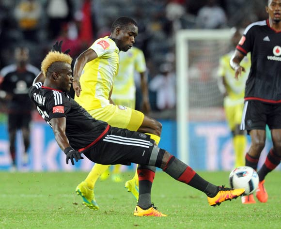 Edwin Gyimah of Orlando Pirates tackles Charlton Mashumba of Jomo Cosmos during the Absa Premiership match between Orlando Pirates and Jomo Cosmos on 12 March 2016 at Orlando Stadium Pic Sydney Mahlangu/ BackpagePix