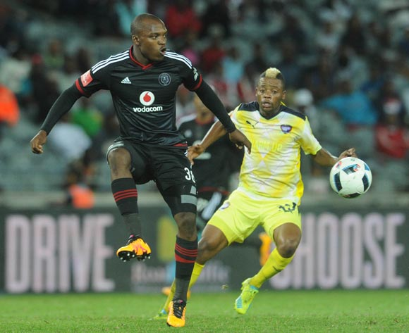 Gift Motupa of Orlando Pirates is challenged by Pentjie Zulu of Jomo Cosmos  during the Absa Premiership match between Orlando Pirates and Jomo Cosmos on 12 March 2016 at Orlando Stadium Pic Sydney Mahlangu/ BackpagePix