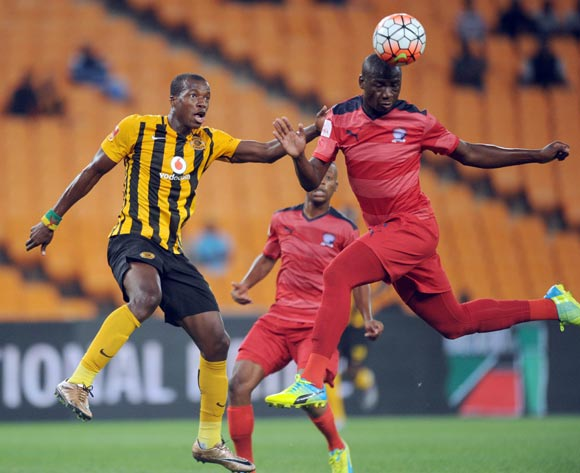 Pilot Mthembu of Jomo Cosmos clears the ball ahead of  Camaldine Abraw of Kaizer Chiefs during the  Premiership match between Kaizer Chiefs and Jomo Cosmos on 15 March 2016 at FNB Stadium Pic Sydney Mahlangu/ BackpagePix