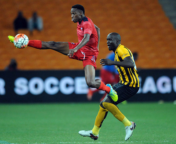 Mxolisi Macuphu of Jomo Cosmos is challenged by Ivan Bukenya of Kaizer Chiefs during the  Premiership match between Kaizer Chiefs and Jomo Cosmos on 15 March 2016 at FNB Stadium Pic Sydney Mahlangu/ BackpagePix