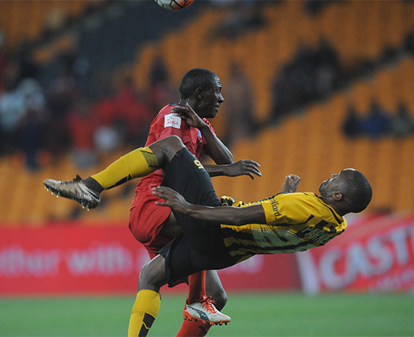Micium Mhone of Jomo Cosmos challenges Bernard Parker of Kaizer Chiefs during the  Premiership match between Kaizer Chiefs and Jomo Cosmos on 15 March 2016 at FNB Stadium Pic Sydney Mahlangu/ BackpagePix