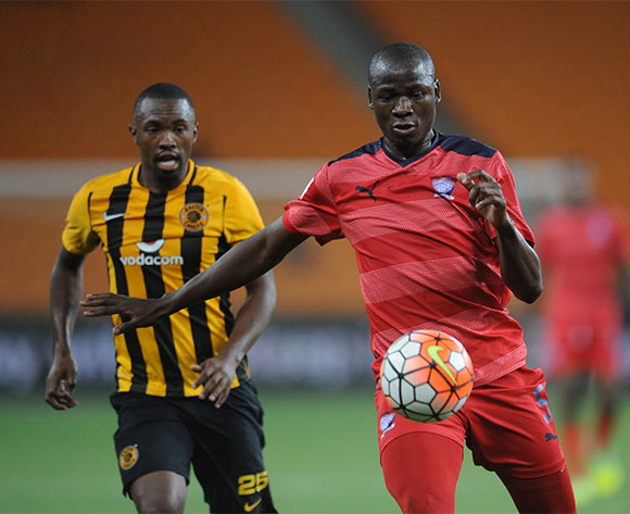Pilot Mthembu of Jomo Cosmos clears the ball ahead of  Bernard Parker of Kaizer Chiefs during the  Premiership match between Kaizer Chiefs and Jomo Cosmos on 15 March 2016 at FNB Stadium Pic Sydney Mahlangu/ BackpagePix