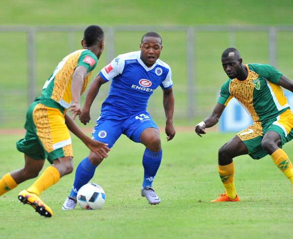 Thuso Phala (c) of Supersport United challenged by Matome Mathiane (l) and Deon Hotto (r) of Golden Arrows during the Absa Premiership match match between Golden Arrows and SuperSport United at the Chatsworth Stadium in Kwa-Zulu Natal, South Africa on March 19, 2016 ©Samuel Shivambu/BackpagePix