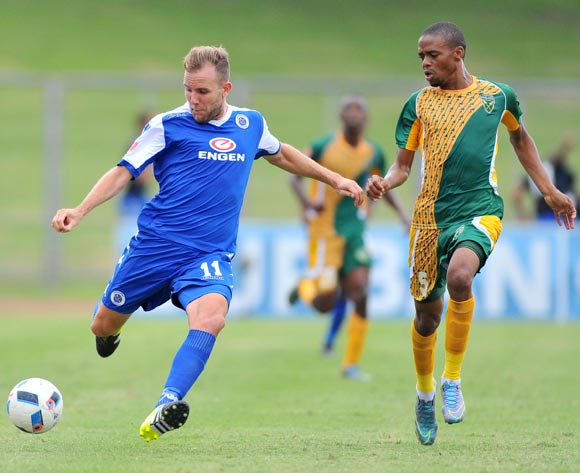 Jeremy Brockie (l) of Supersport United challenged by Gladwin Shitolo  (r) of Golden Arrows during the Absa Premiership match match between Golden Arrows and SuperSport United at the Chatsworth Stadium in Kwa-Zulu Natal, South Africa on March 19, 2016 ©Samuel Shivambu/BackpagePix