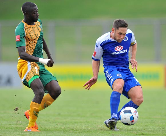Dean Furman (r) of Supersport United challenged by Deon Hotto (l) of Golden Arrows during the Absa Premiership match match between Golden Arrows and SuperSport United at the Chatsworth Stadium in Kwa-Zulu Natal, South Africa on March 19, 2016 ©Samuel Shivambu/BackpagePix