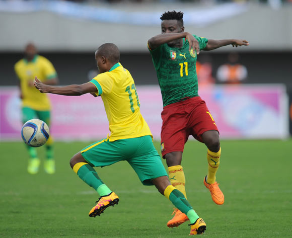 Thabo Matlaba of South Africa is challenged by Edgard Salli of Cameroon during the AFCON Qualifier match  between Cameroon and South Africa on 26 March 2016 at Limbe Omni Sport Stadium  Pic Sydney Mahlangu/ BackpagePix