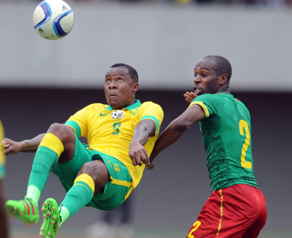 Thamsanqa Gabuza of South Africa is challenged by Allan Nyom of Cameroon  during the AFCON Qualifier match  between Cameroon and South Africa on 26 March 2016 at Limbe Omni Sport Stadium  Pic Sydney Mahlangu/ BackpagePix