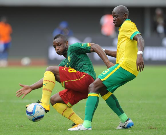 Hlompho Kekana of South Africa challenges Sebastien Siani of Cameroon  during the AFCON Qualifier match  between Cameroon and South Africa on 26 March 2016 at Limbe Omni Sport Stadium  Pic Sydney Mahlangu/ BackpagePix