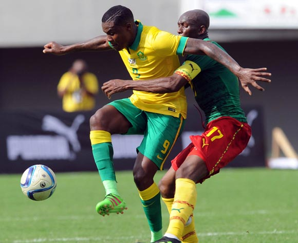 Thamsanqa Gabuza of South Africa challenges Stephane Mbia of Cameroon  during the AFCON Qualifier match  between Cameroon and South Africa on 26 March 2016 at Limbe Omni Sport Stadium  Pic Sydney Mahlangu/ BackpagePix