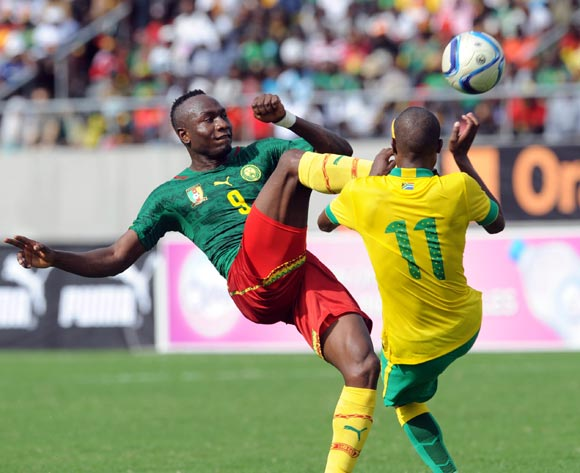 Thabo Matlaba of South Africa is challenged by Jacques Zoua of Cameroon during the AFCON Qualifier match  between Cameroon and South Africa on 26 March 2016 at Limbe Omni Sport Stadium  Pic Sydney Mahlangu/ BackpagePix