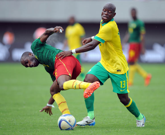 Hlompho Kekana of South Africa challenges Allan Nyom of Cameroon  during the AFCON Qualifier match  between Cameroon and South Africa on 26 March 2016 at Limbe Omni Sport Stadium  Pic Sydney Mahlangu/ BackpagePix