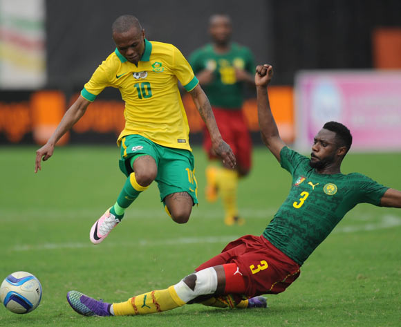 Thulani Serero of South Africa is tackled by Nicolas Nkoulou of Cameroon  during the AFCON Qualifier match  between Cameroon and South Africa on 26 March 2016 at Limbe Omni Sport Stadium  Pic Sydney Mahlangu/ BackpagePix