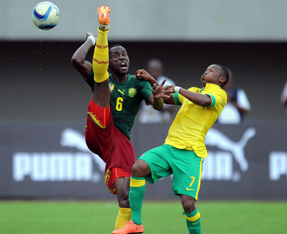 Mandla Masango of South Africa challenges Toni Tchiani of Cameroon during the AFCON Qualifier match  between Cameroon and South Africa on 26 March 2016 at Limbe Omni Sport Stadium  Pic Sydney Mahlangu/ BackpagePix