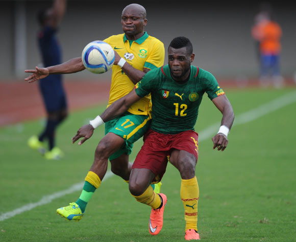 Tokelo Rantie of South Africa challenges Henri Bedroom of Cameroon during the AFCON Qualifier match  between Cameroon and South Africa on 26 March 2016 at Limbe Omni Sport Stadium  Pic Sydney Mahlangu/ BackpagePix